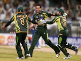 Umar Gul of Pakistan celebrates after dismissing Sri Lanka's batsman Kumar Sangakkra during the third one day international (ODI) cricket match between Pakistan and Sri Lanka at The Sharjah Cricket Stadium in Sharjah, on December 22, 2013