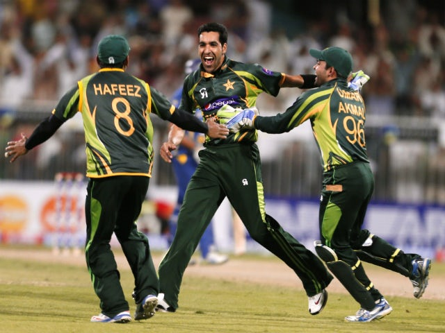Umar Gul of Pakistan celebrates after dismissing Sri Lanka's batsman Kumar Sangakkra during the third one day international (ODI) cricket match between Pakistan and Sri Lanka at The Sharjah Cricket Stadium in Sharjah, on December 22, 2013