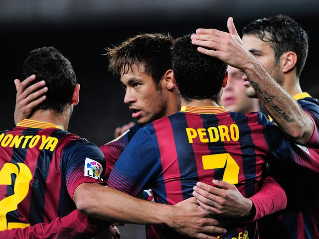 Barcelona's Pedro Rodriguez celebrates with teammates after scoring the opening goal against Cartagena during their Copa del Rey match on December 17, 2013