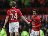 Rafael Da Silva of Manchester United celebrates scoring his team's third goal with team mate Darren Fletcher during the Barclays Premier League match between Manchester United and Wigan Athletic at Old Trafford on December 30, 2009