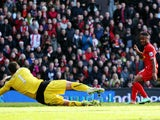 Raheem Sterling of Liverpool slots the ball past David Marshall the Cardiff City goalkeeper to score his sides second goal during the Barclays Premier League on December 21, 2013
