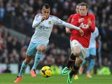 Ravel Morrison of West Ham United competes with Wayne Rooney of Manchester United during the Barclays Premier League match between Manchester United on December 21, 2013
