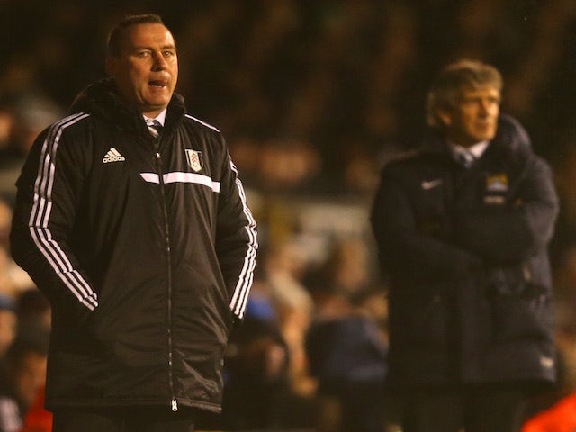 Manager Rene Meulensteen of Fulham looks on during the Barclays Premier League match between Fulham and Manchester City at Craven Cottage on December 21, 2013