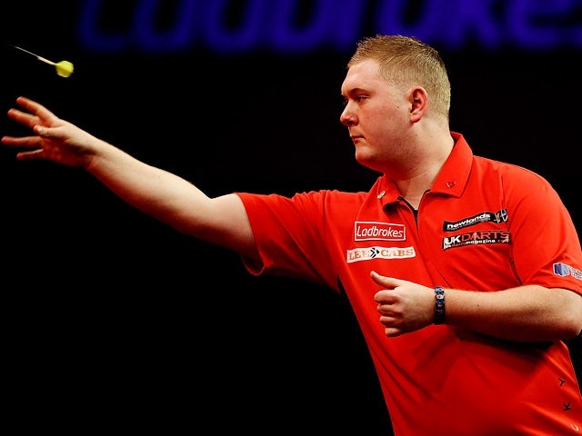 Ricky Evans in action against Ronnie Baxter during their first round match of the World Darts Championship on December 16, 2013