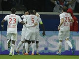 Lille's French midfielder Rio Mavuba celebrates with teammates after scoring a goal during the French L1 football match against Paris Saint-Germain on December 22, 2013