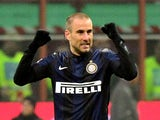 Inter Milan's Argentinian forward Rodrigo Palacio celebrates after scoring during the Italian Serie A football match Inter Milan vs AC Milan at San Siro Stadium in Milan on December 22, 2013