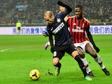 AC Milan's French defender Kevin Constant fights for the ball with Inter Milan's Argentinian forward Rodrigo Palacio during the Italian Serie A football match on December 22, 2013