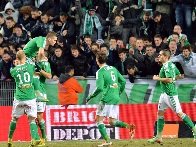 St Etienne's French forward Mevlut Erding is congratulated by his teammates after scoring during the French L1 football match Saint-Etienne (ASSE) vs Nantes (FCNA) on December 21, 2013