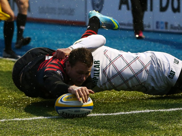 Jack Wilson of Saracens dives over for the first try during the Aviva Premiership match between Saracens and Leicester Tigers at Allianz Park on December 21, 2013