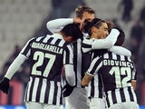 Sebastian Giovinco of Juventus celebrates with team-mates after scoring the opening goal with team-mate during the Tim Cup match against US Avellino on December 18, 2013