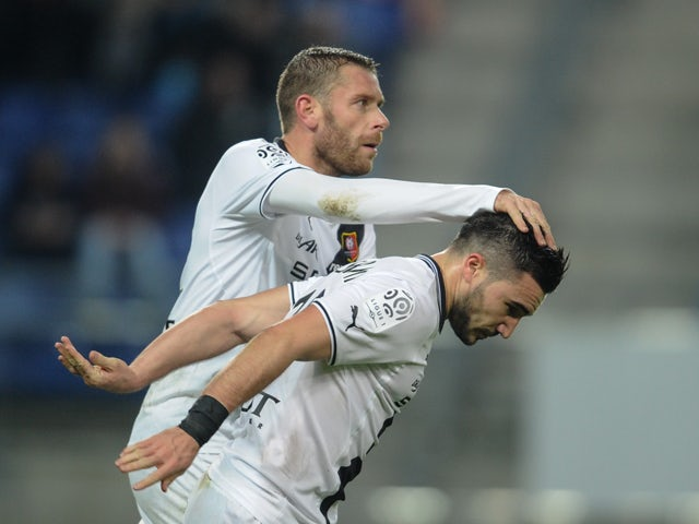Rennes' French forward Romain Alessandrini is congratulated by Rennes' French defender Sylvain Armand (R) after scoring during the French L1 football match Sochaux (FCSM) against Rennes (SRFC) on December 21, 2013