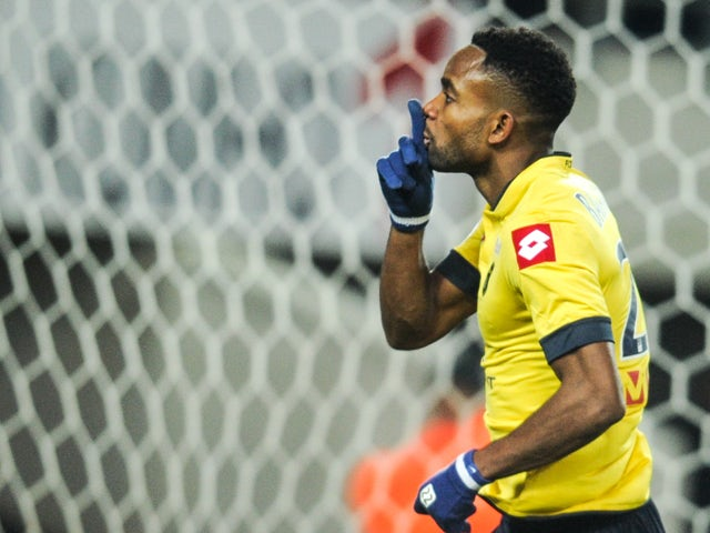 Sochaux' French forward Cedric Bakambugestures after scoring a goal during the French L1 football match Sochaux (FCSM) against Rennes (SRFC) on December 21, 2013