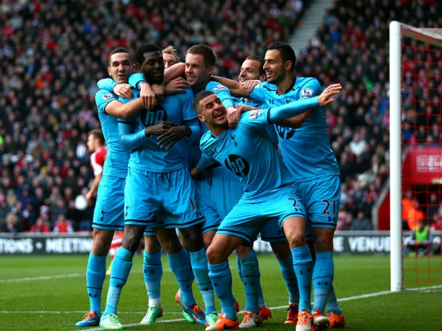 Emmanuel Adebayor of Spurs celebrates with teammates after scoring his team's third goal during the Barclays Premier League match between Southampton and Tottenham Hotspur at St Mary's Stadium on December 22, 2013