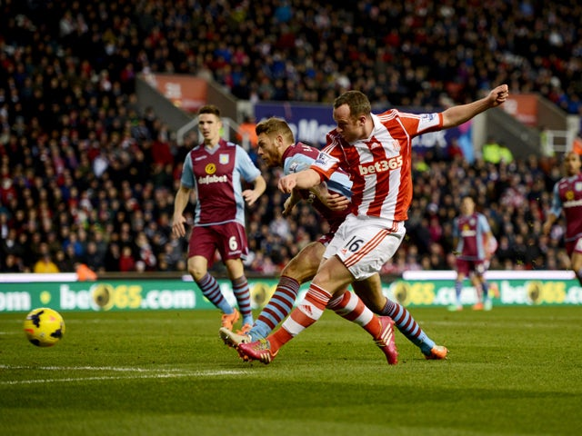 Charlie Adam of Stoke City scores their first goal during the Barclays Premier League match between Stoke City and Aston Villa at Britannia Stadium on December 21, 2013