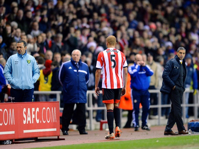 Wes Brown of Sunderland walks off the pitch after being sent off for a challenge on Robert Snodgrass of Norwich City during the Barclays Premier League match between Sunderland and Norwich City at the Stadium of Light on December 21, 2013