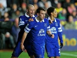 Seamus Coleman of Everton is congratulated by teammate Ross Barkley of Everton after scoring the opening goal during the Barclays Premier League match between Swansea City and Everton at the Liberty Stadium on December 22, 2013