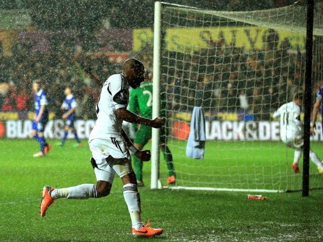 Dwight Tiendalli of Swansea's celebrates after his header on goal is deflected by Bryan Oviedo of Everton for an own goal during the Barclays Premier League match between Swansea City and Everton at the Liberty Stadium on December 22, 2013