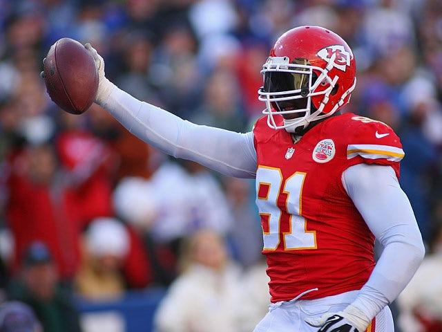 Tamba Hali #91 of the Kansas City Chiefs celebrates after scoring the game winning touchdown against Buffalo Bills on November 5, 2013