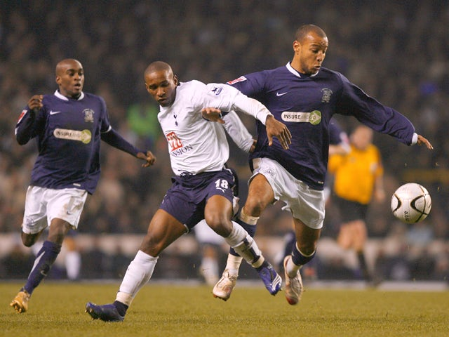 Jermain Defoe of Tottenham Hotspur tussles with Lewis Hunt of Southend United during the Carling Cup Quarter Final match between Tottenham Hotspur and Southend United at White Hart Lane on December 20, 2006