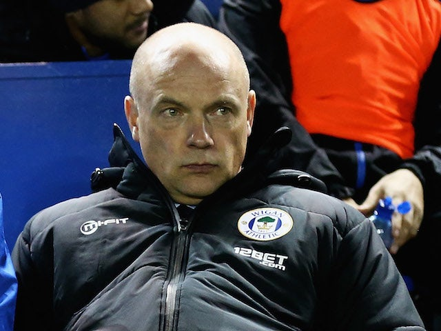New manager of Wigan Athletic, Uwe Rosler, looks on during the Sky Bet Championship match between Sheffield Wednesday and Wigan Athletic at Hillsborough Stadium on December 18, 2013