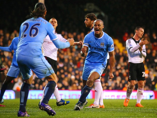 Vincent Kompany of Manchester City celebrates scoring their second goal with Martin Demichelis of Manchester City during the Barclays Premier League match on December 21, 2013