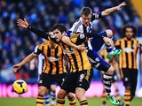 Danny Graham of Hull City and Alex Bruce of Hull City challenge for the ball during the Barclays Premier League match between West Bromwich Albion and Hull City at The Hawthorns on December 21, 2013