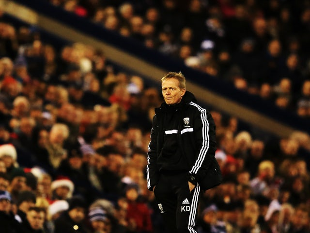West Bromwich Albion caretaker manager Keith Downing reacts on the touchline during the Barclays Premier League match between West Bromwich Albion and Hull City at The Hawthorns on December 21, 2013