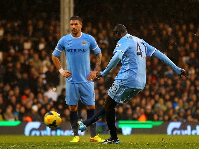 Yaya Toure of Manchester City scores the first goal from a freekick during the Barclays Premier League match against Fulham on December 21, 2013