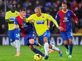 Newcastle United's French striker Yoan Gouffran vies for the ball with Crystal Palace's English defender Joel Ward during the English Premier League game on December 21, 2013