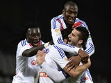 Lyon's Bafetimbi Gomis, Mohamed Fofana and Alexandre Lacazette congradulate Yoann Gourcuff after a goal against Reims on December 18, 2013