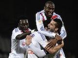 Lyon's Bafetimbi Gomis, Mohamed Fofana and Alexandre Lacazette congradulate Yoann Gourcuff after a goal against Reims on December 18, 2013