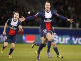 Paris Saint-Germain's Swedish forward Zlatan Ibrahimovic (R) celebrates after scoring a goal during the French L1 football match between Paris Saint-Germain (PSG) and Lille on December 22, 2013