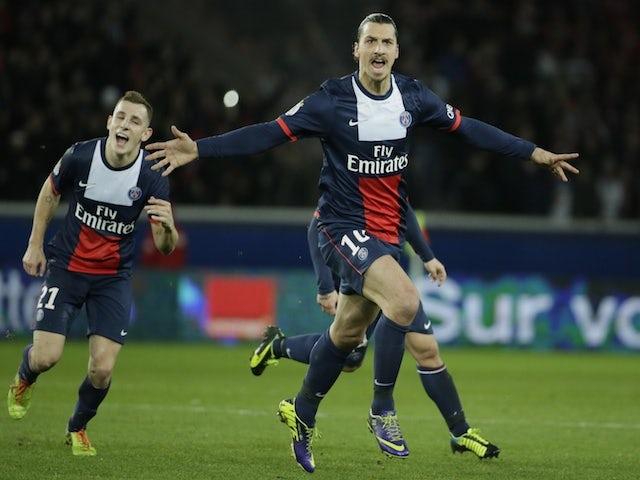 Paris Saint-Germain's Swedish forward Zlatan Ibrahimovic (R) celebrates after scoring a goal during the French L1 football match between Paris Saint-Germain (PSG) and Lille on December 22, 2013