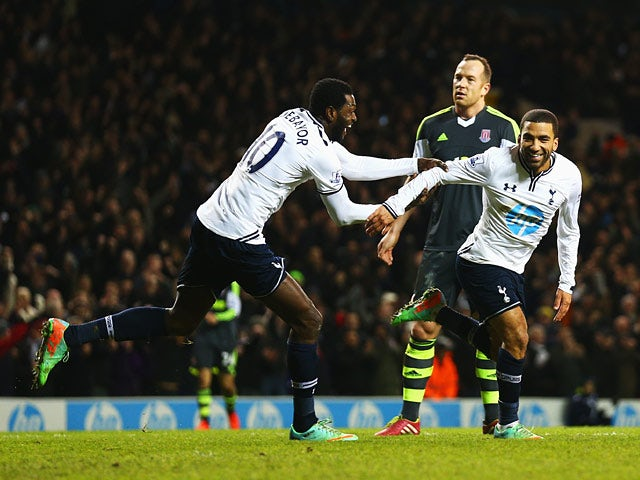 Tottenham's Aaron Lennon is congratulated by teammate Emmanuel Adebayor after scoring his team's third goal against Stoke during their Premier League match on December 29, 2013