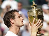 Andy Murray celebrates with the Wimbledon trophy on July 07, 2013.