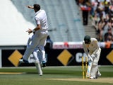 England's James Anderson leaping into the air after bowling the Australian captain Michael Clarke for 10 runs on the second day of the fourth Ashes cricket Test match against Australia in Melbourne on December 27, 2013
