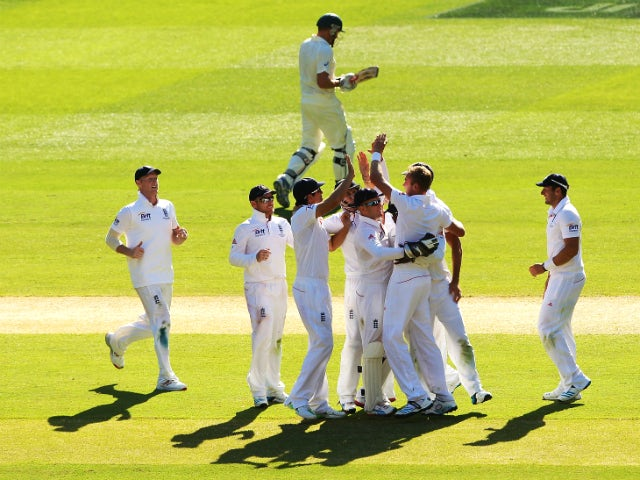 Stuart Broad of England celebrates with team mates after taking the wicket of Ryan Harris of Australia during day two of the Fourth Ashes Test Match between Australia and England at Melbourne Cricket Ground on December 27, 2013