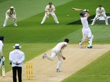 Mitchell Johnson of Australia bowls out Kevin Pietersen of England during day two of the Fourth Ashes Test Match between Australia and England at Melbourne Cricket Ground on December 27, 2013