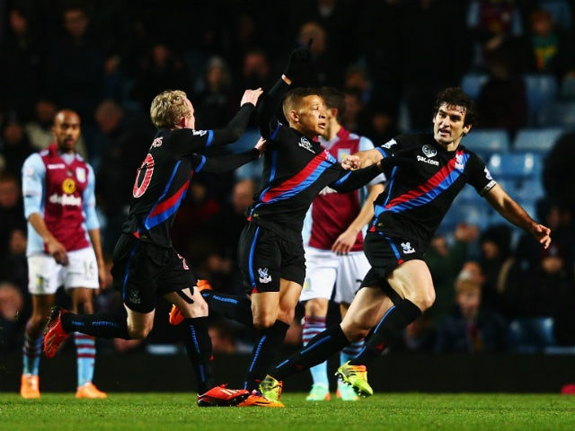 Dwight Gayle of Crystal Palace celebrates with team mates after scoring the winning goal during the Barclays Premier League match between Aston Villa and Crystal Palace at Villa Park on December 26, 2013