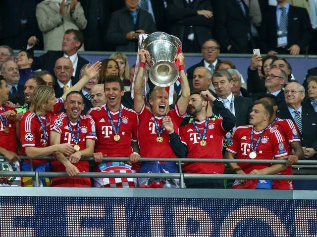 Bayern Munich celebrate with the Champions League trophy on May 25, 2013.