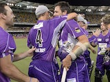 Ben Hilfenhaus of the Hurricanes celebrates victory with team mates during the Big Bash League match between Brisbane Heat and the Hobart Hurricanes on December 28, 2013