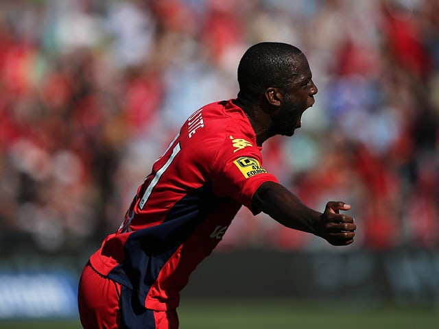 Adelaide United's Bruce Djite celebrates after scoring the opening goal against Newcastle Jets during their A-League match on December 29, 2013