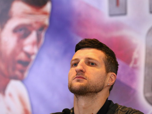 Carl Froch faces the media during a press conference to promote his upcoming fight against George Groves at the Radisson Blu Edwardian Hotel on September 17, 2013