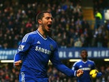 Eden Hazard of Chelsea celebrates scoring the first goal during the Barclays Premier League match between Chelsea and Swansea City at Stamford Bridge on December 26, 2013