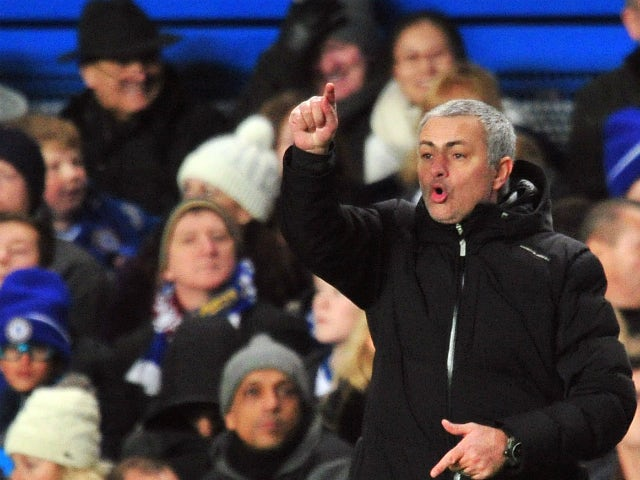 Chelsea's Portuguese manager Jose Mourinho gestures during the English Premier League football match between Chelsea and Swansea City at Stamford Bridge in London on December 26, 2013