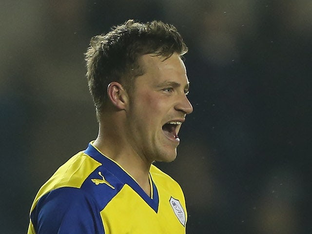 Chris Maguire of Sheffield Wednesday celebrates scoring a goal during the npower Championship match between Millwall and Sheffield Wednesday at The New Den on April 9, 2013