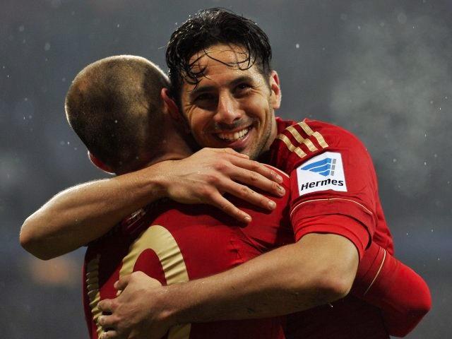 Bayern Munich's Claudio Pizarro celebrates scoring against Hamburg on March 30, 2013.