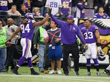 Cordarrelle Patterson of the Minnesota Vikings celebrates a touchdown with head coach Leslie Frazier of the Minnesota Vikings against the Detroit Lions on December 29, 2013