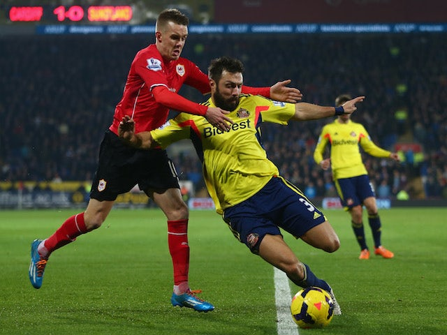 Craig Noone of Cardiff City challenges Andrea Dossena of Sunderland during the Barclays Premier League match on December 28, 2013