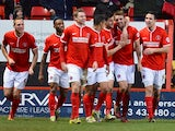 Charlton's Dale Stephens celebrates with teammates after scoring the opening goal against Sheffield Wednesday during their Championship match on December 29, 2013